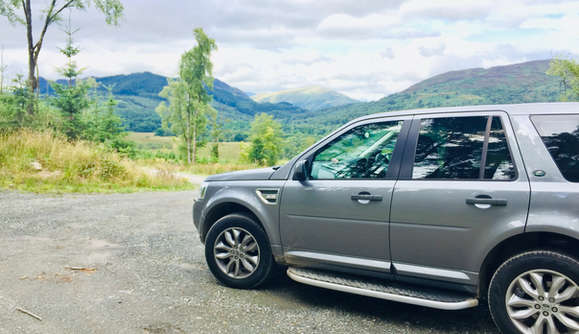 luxury private vehicle off road on a tour to loch lomond national park