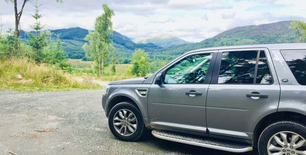 luxury private vehicle off road on a luxury private tour near loch lomond