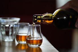 whisky poured into glass on table on private whisky experience tour in scotland