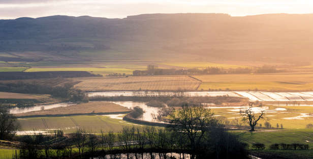 lowland perthshire in scotland with farmland hills fields and sky
