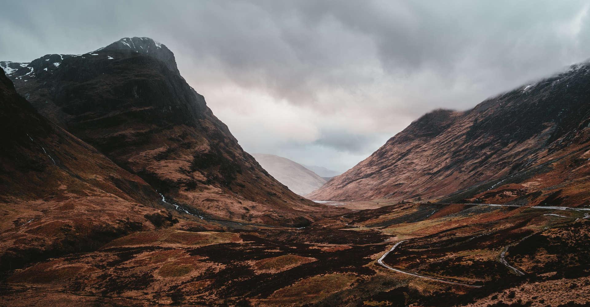 road through glencoe scotland with mountains and sky