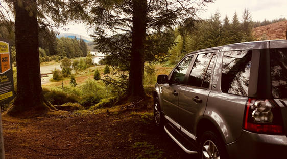luxury private vehicle on tour in trossachs national park near loch lomond