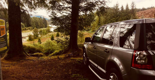 luxury private vehicle in forest on outlander tour in scotland