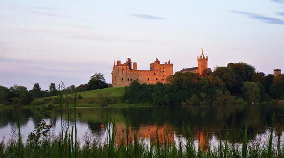 Linlithgow Palace near edinburgh scotland with clear sky and loch below
