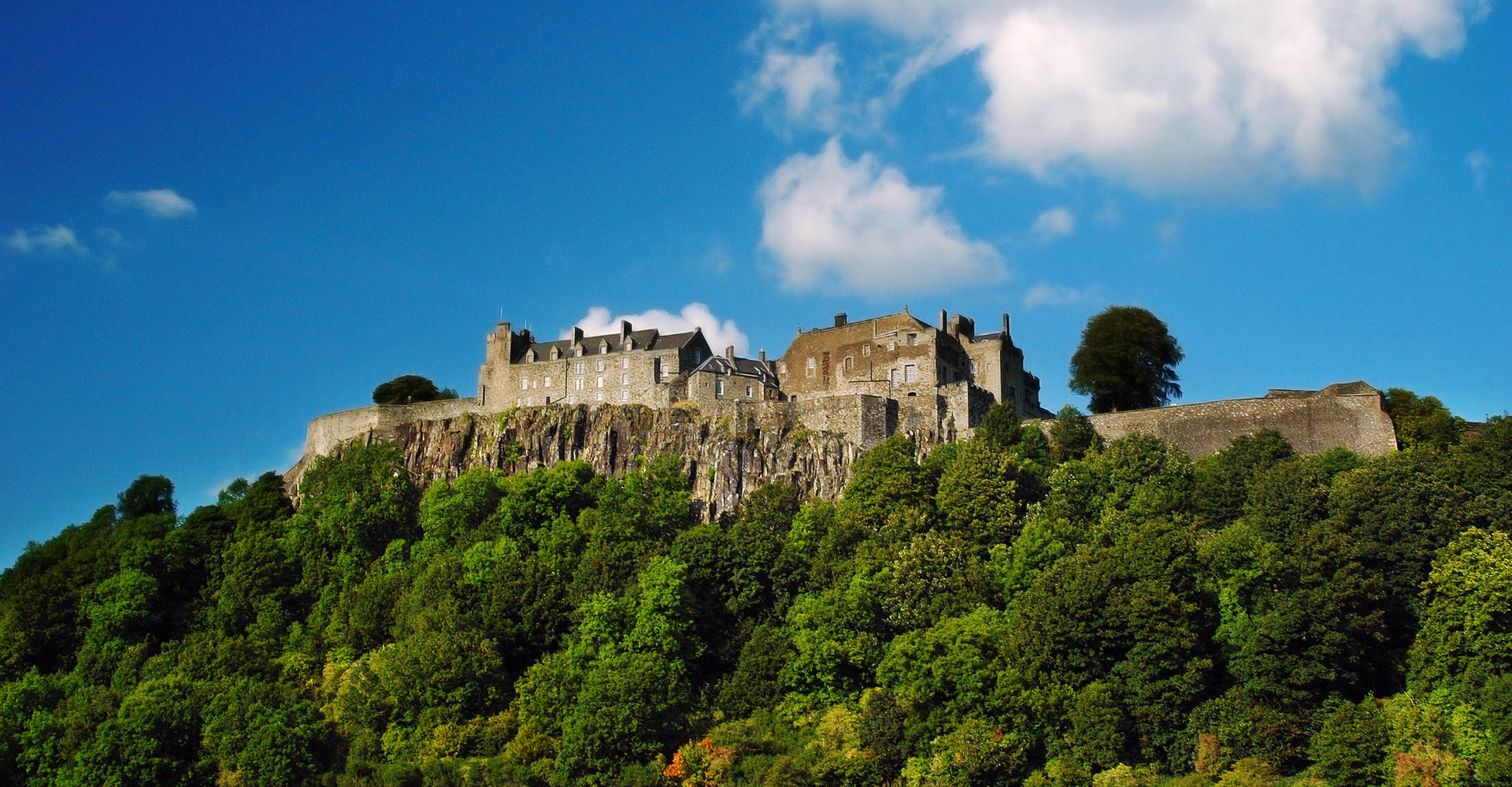 Stirling Castle Scotland from below with blue sky sunny day