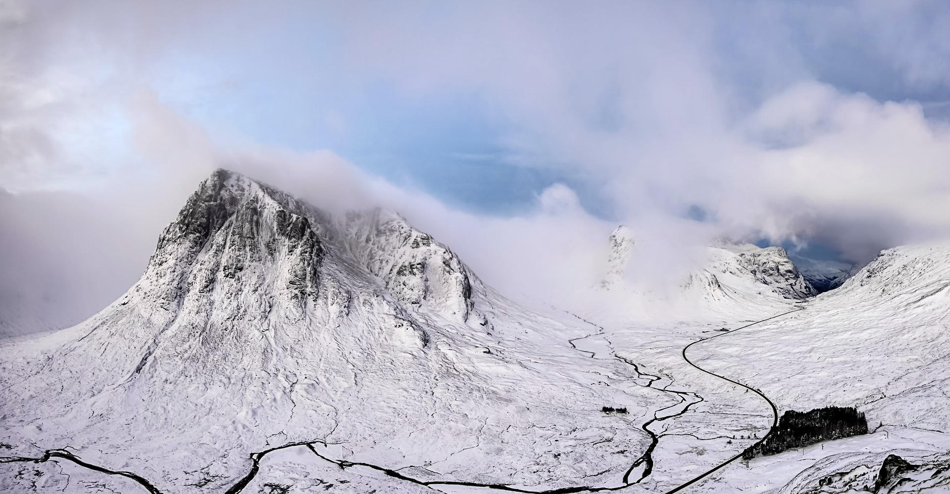 mountains of Glencoe scotland covered in snow