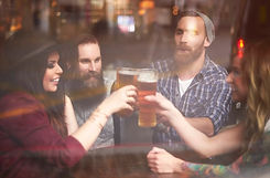 friends having fun drinking beer on private tour