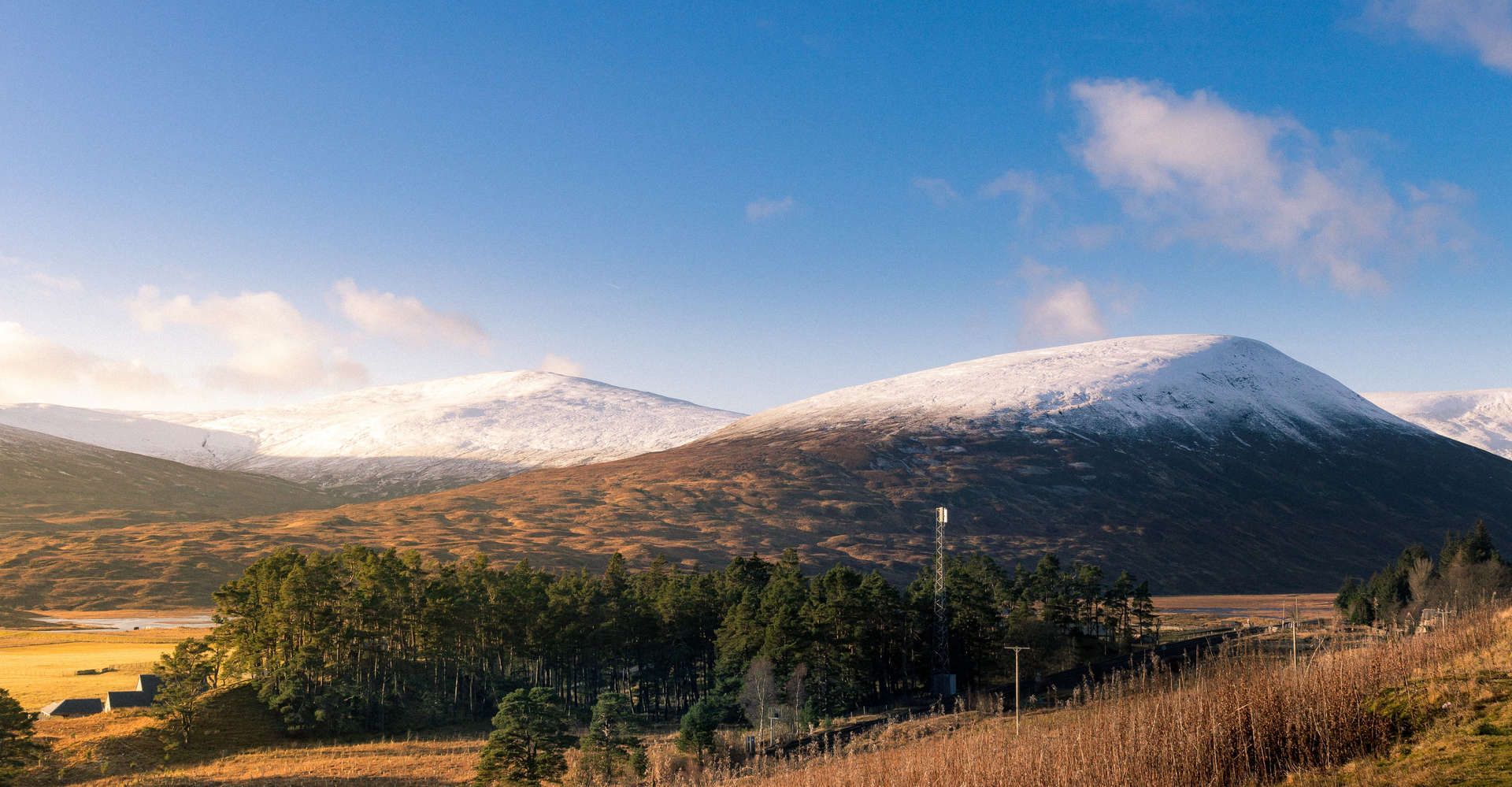 snowy mountains in perthshire scotland with blue sky