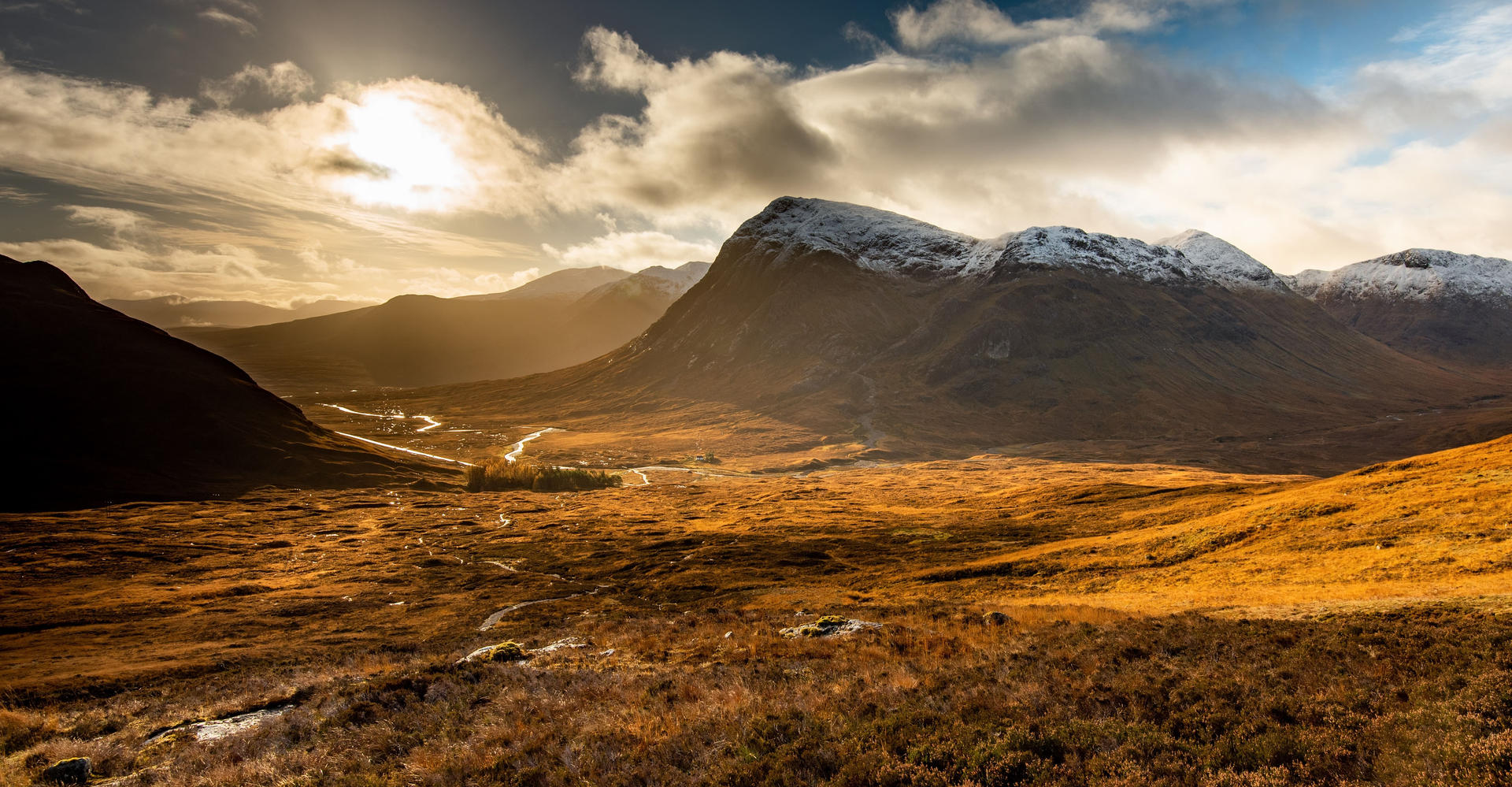 moutnains of glencoe scotland with sunny skye and brown heather