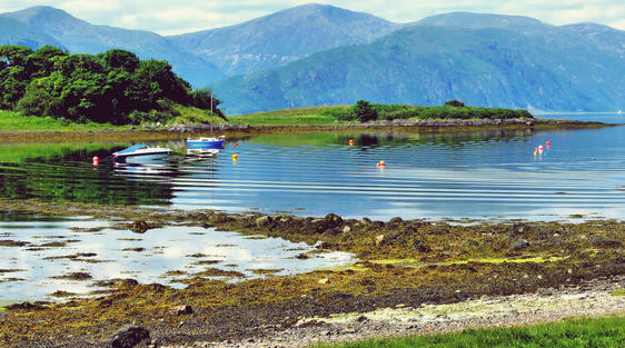 scenery near oban scotland with blie sky and mountains and loch