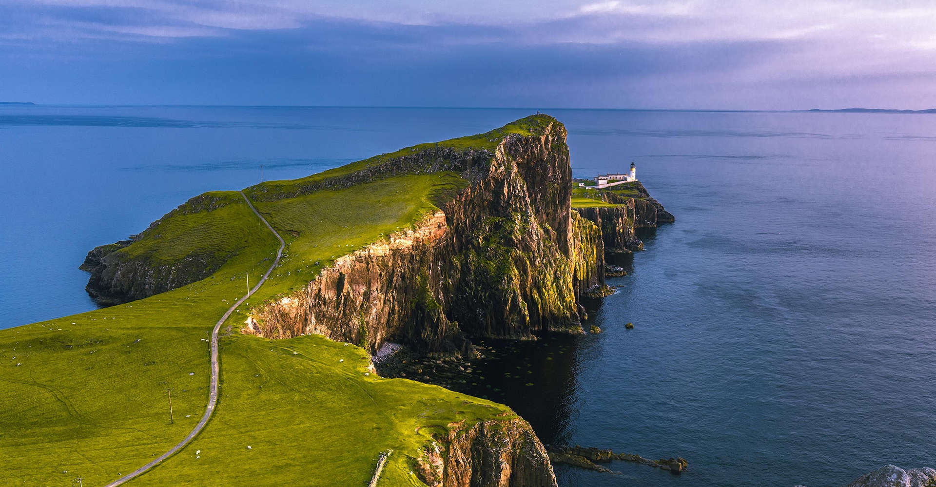 neist point on the isle of skye scotland with open blue sea and sky
