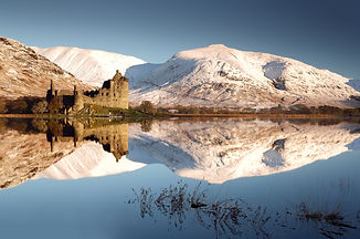 tour of Kilchurn Castle in front of snowy mountains in scotland