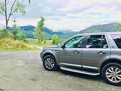 Luxury vehicle off road on private tour in scotland