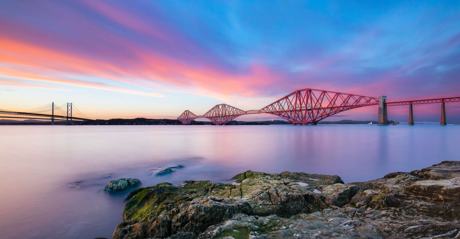view of forth bridge at sunset in scotland