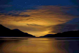loch ness seen at dusk with dark sky and mountains