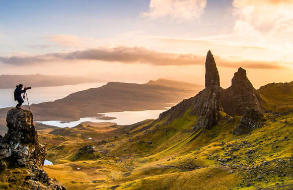 man on luxury private tour taking photo of old man of storr isle of skye scotland