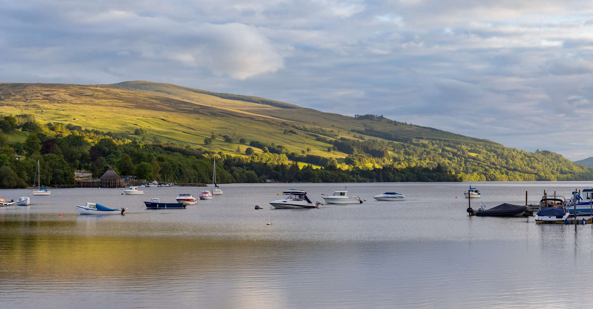 Loch Tay from Kenmore scotland with calm water and mountains and sky