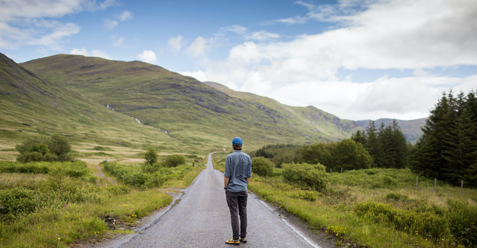man on luxury private whisky tour in scotland standing in road