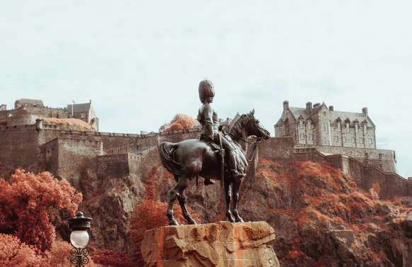 Edinburgh Castle with man on horse statue in front