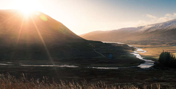 highland perthshire scotland with mountains and a road beside a river