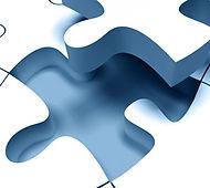 Puzzelstuk dat in een puzzel gepast wordt
