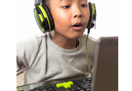 child with headphones.png