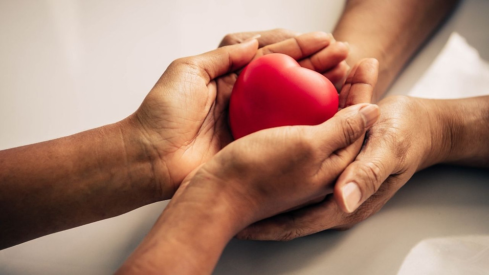 hands holding a heart. foster care vs adoption. ontario foster care