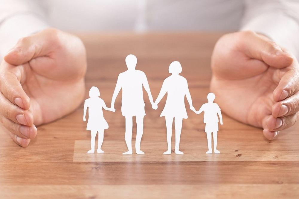 Hands around family foster care
