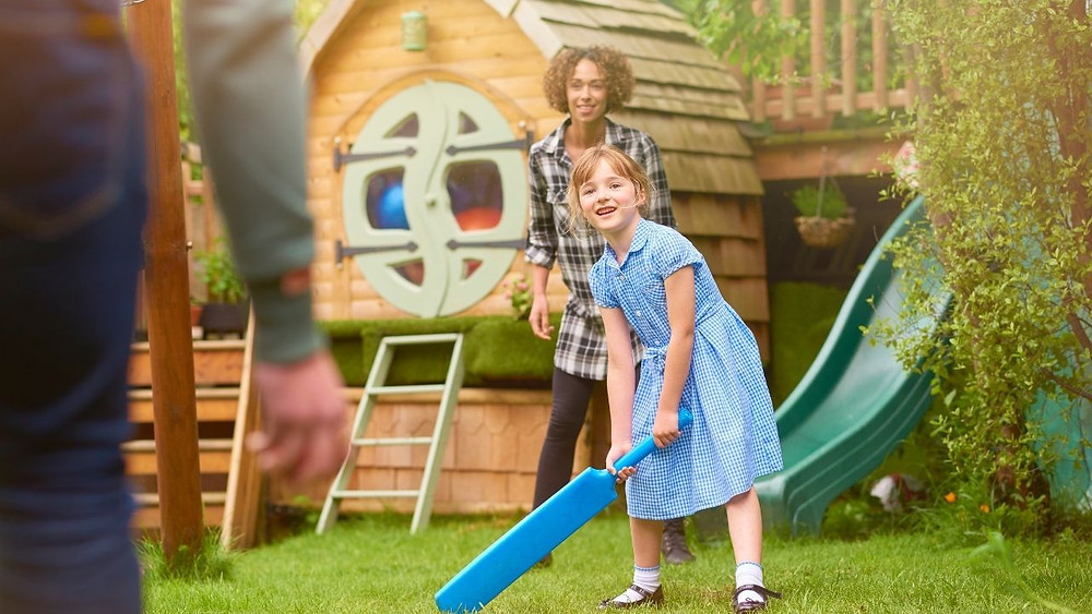 foster child and foster parents outside playing. foster care vs adoption
