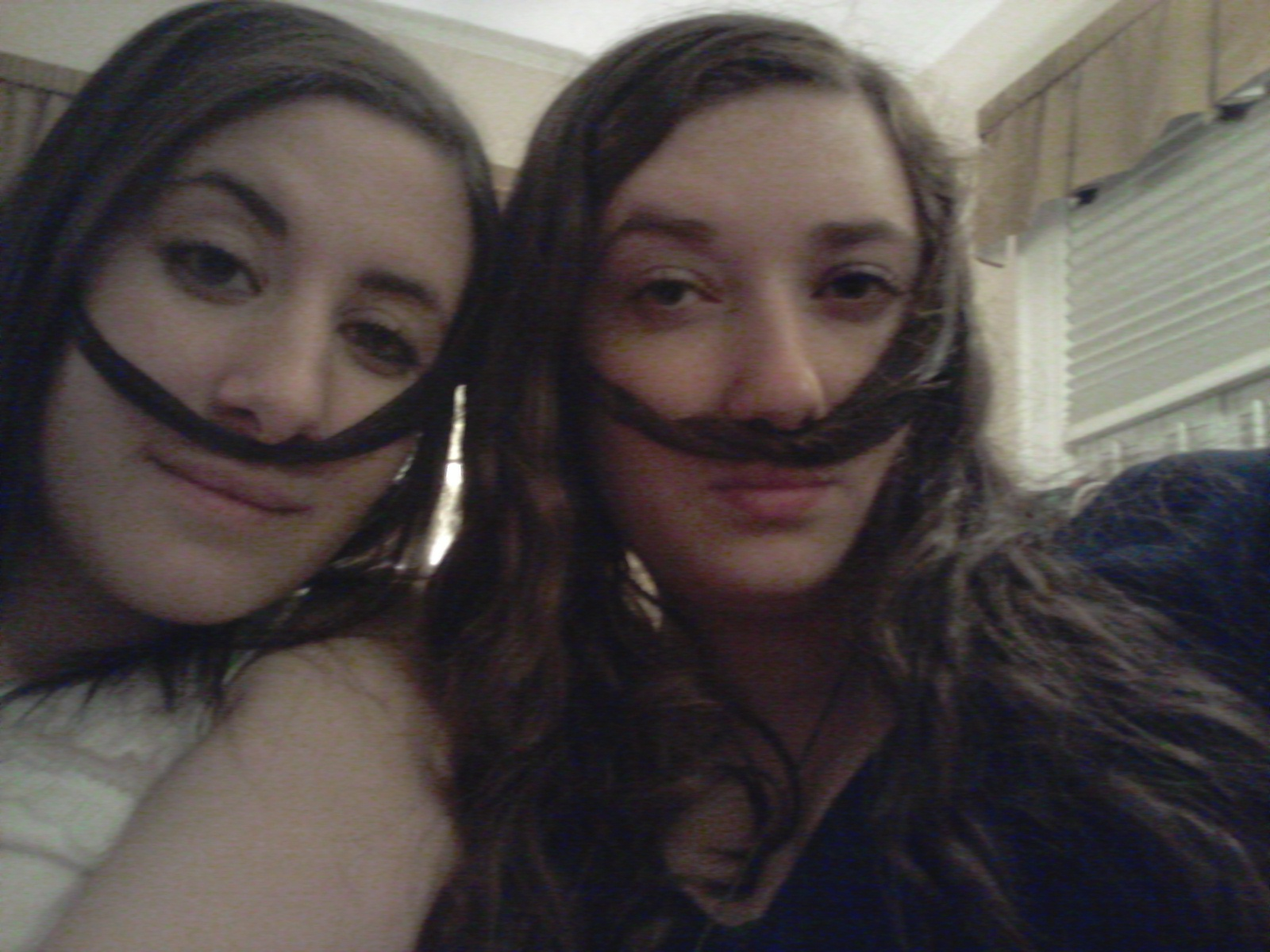mustached sisters
