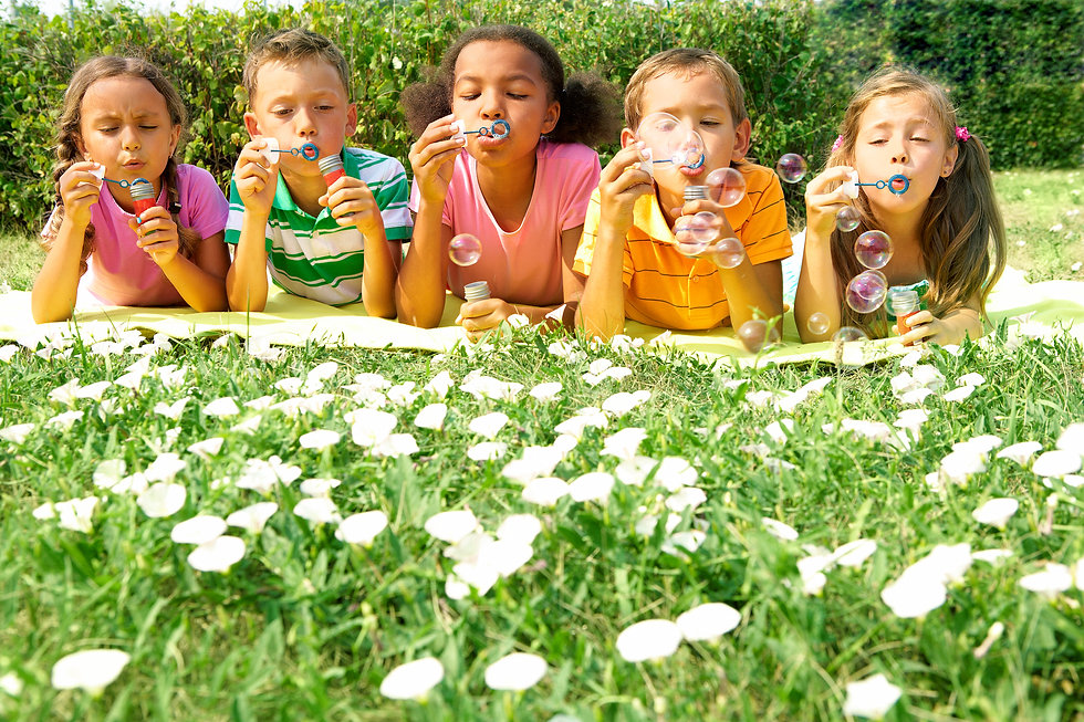 shutterstock_Multicultural Kids_blowing