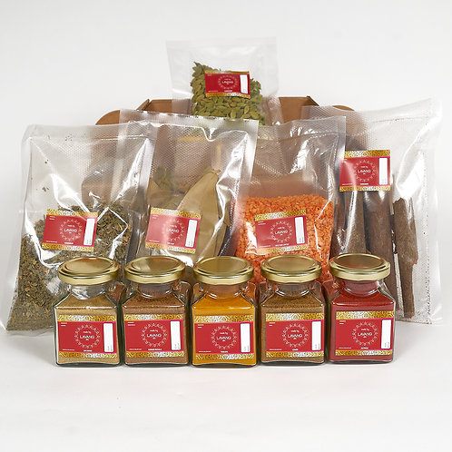 Front view, mixed spice assortment, red branded glass jars and packaging