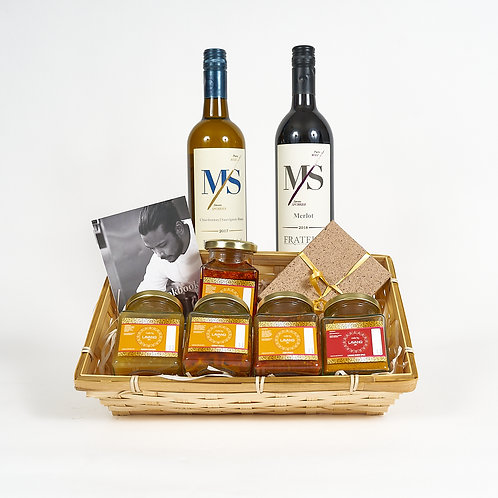 Front facing gift hamper includes Cookbook, Wines, Spices, Sauces, chocolate truffle