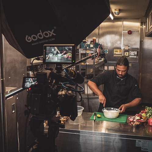 Front facing Chef Jay, surrounded by videography equipment, cameras, lighting, sound system