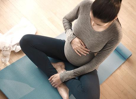Pregnant Woman Practicing Yoga_edited.jp