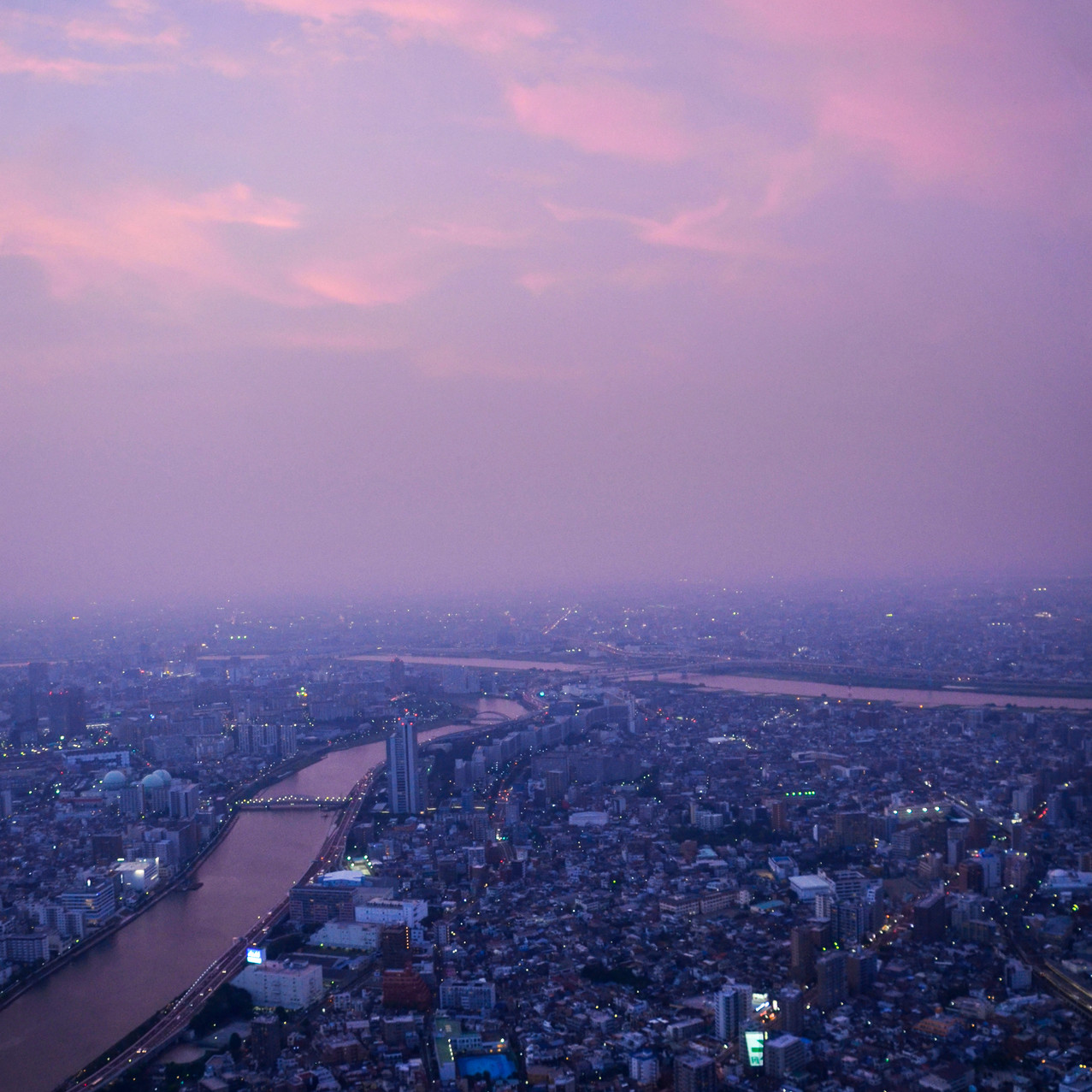 The view on the city during the sunset from the Tokyo Skytree Observation Deck.
