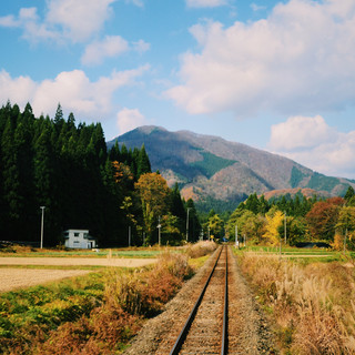 The view on autumn leaves from the Akita Nairiku Line train.
