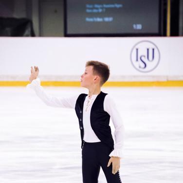 Lev Vinokur performing his free program at the ISU Junior Grand Prix Riga 2019.