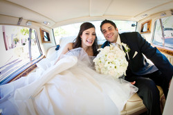 Bride and Groom in their Limo