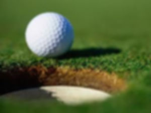 Golf Ball Beside Hole