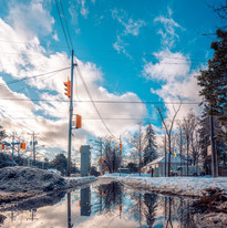reflection-of-utility-pole-on-water-3424
