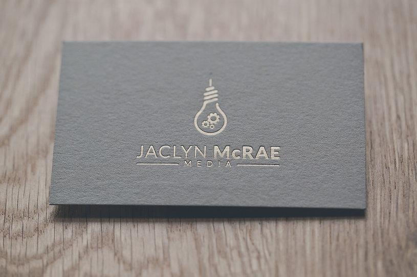 Jaclyn McRae Media | matte pale gold foil-press on grey stock