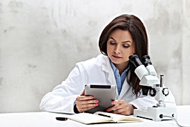 woman-working-in-the-lab-with-microscope