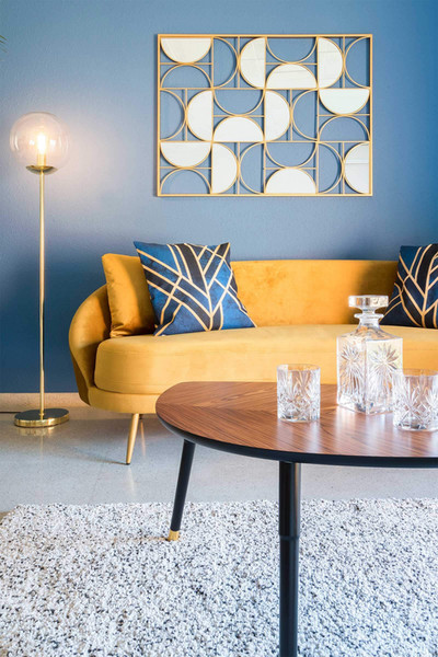 Living room decorated with a vintage yellow velvet sofa by Maisons du monde