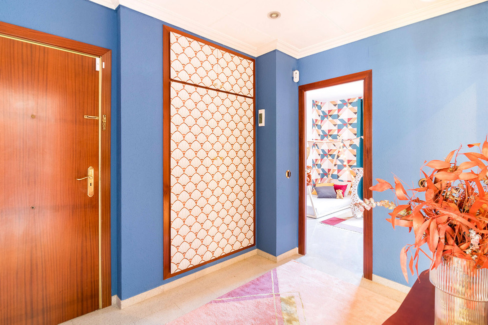 Hallway decorated with Art Deco wallpaper