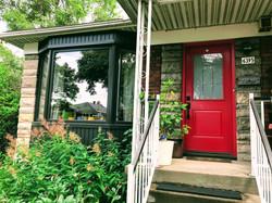 Bay Window and a red Fenplast door