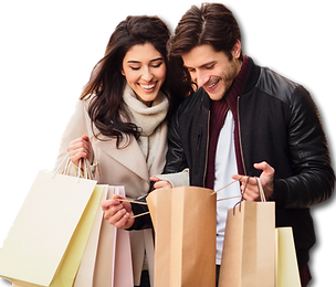 excited-couple-looking-into-shopping-bag