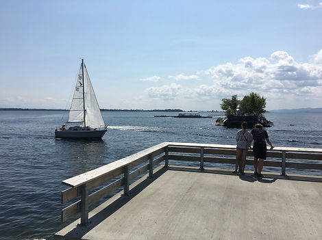Sailboat in Burlington Harbor viewed from the Waterfront pier