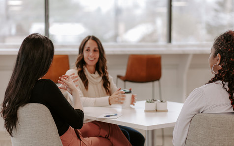 Therapists discussing topics around a table
