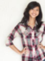 happy young beautiful asian girl posing